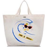 sac-de-plage-toile-choupette-sur-un-surf
