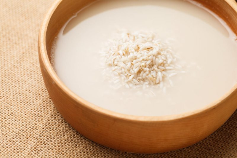 Wash rice in wooden bowl